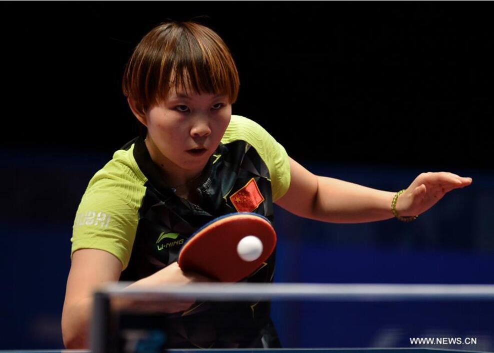 Zhu Yuling of China returns a shot to Sato Hitomi of Japan during the women