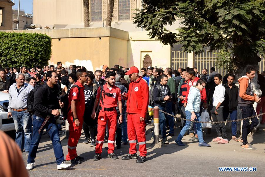 Medical personnel arrive at the explosion site in Cairo, Egypt on Dec. 11, 2016. At least 25 people were killed and 49 others injured on Sunday in an explosion at the Coptic Cathedral in Abbasiya
