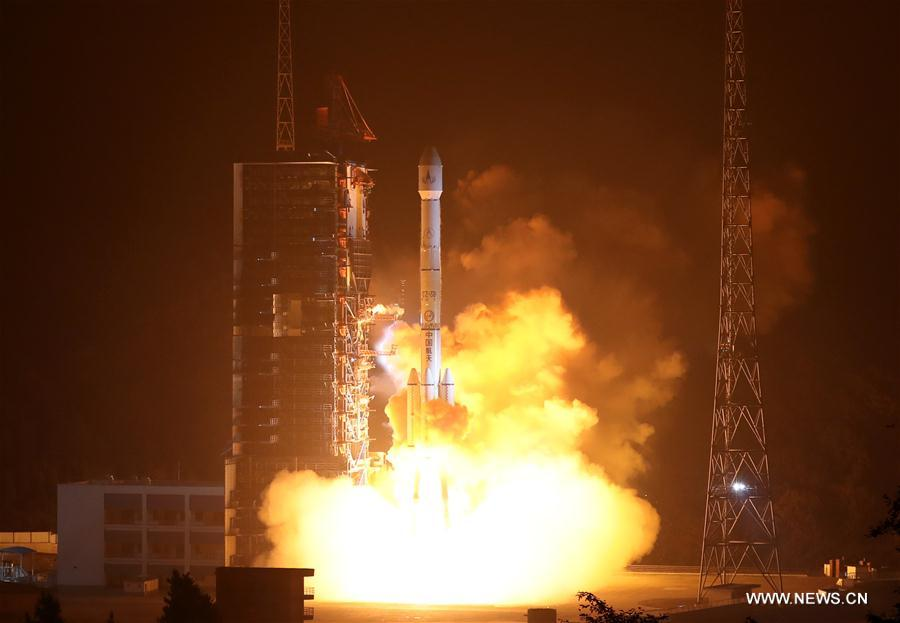 A Long March-3B rocket carrying the Fengyun-4 satellite blasts off from the launching pad at Xichang Satellite Launch Center, southwest China