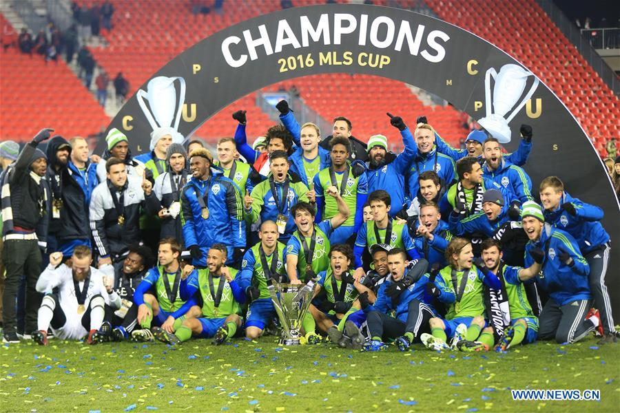 Memebers of Seattle Sounders FC celebrate during the awarding ceremony of the 2016 Major League Soccer(MLS) Cup in Toronto, Canada, Dec. 10, 2016. Seattle Sounders FC won 5-4 and claimed the title. (Xinhua/Zou Zheng)