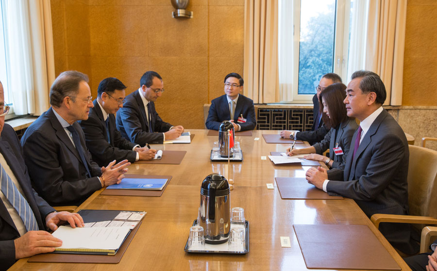 Chinese Foreign Minister Wang Yi meeting on Sunday with Michael Moller, the Director-General of the United Nations Office in Geneva.