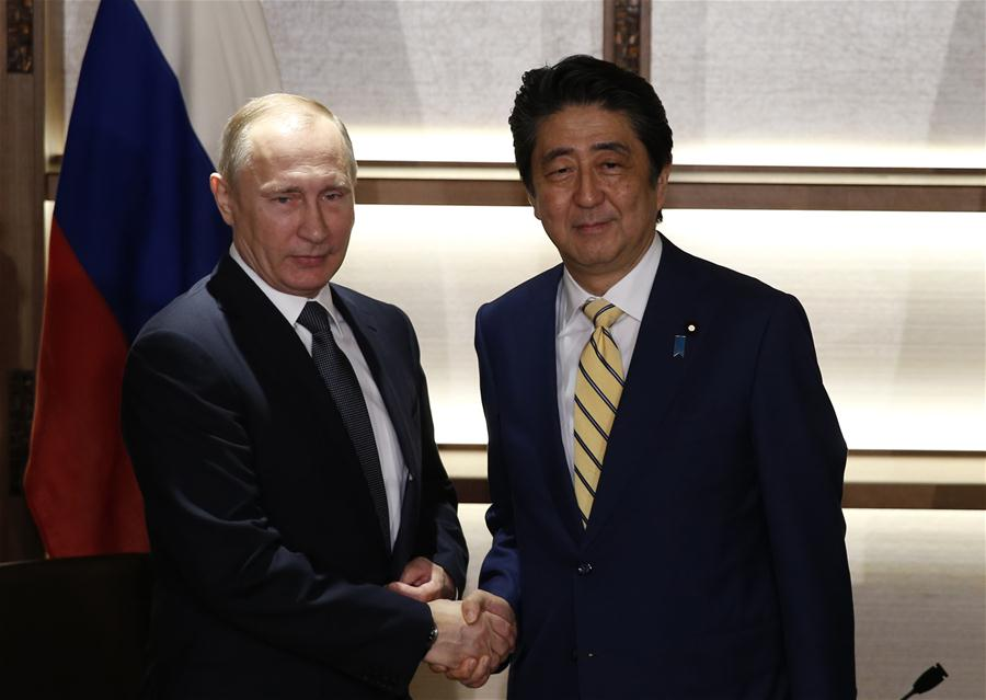 Russian President Vladimir Putin (L) shakes hands with Japanese Prime Minister Shinzo Abe prior to their meeting in Nagato, Yamaguchi prefecture, Japan, Dec. 15, 2016. Russian President Vladimir Putin held talks with Japanese Prime Minister Shinzo Abe here on Thursday focusing on a decades-old territorial dispute and a post-war peace treaty. (Xinhua)