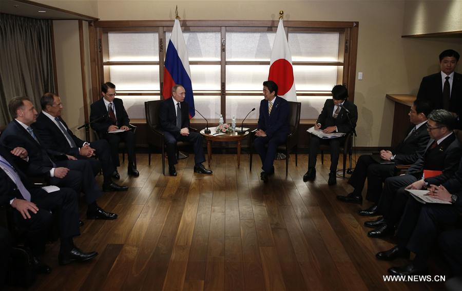 Rencontre au sommet des dirigeants, entre Vladimir Poutine et Shinzo Abe