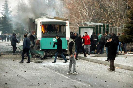 A suicide car bombing has killed 14 soldiers and wounded dozens more in the central city of Kayseri of Turkey.