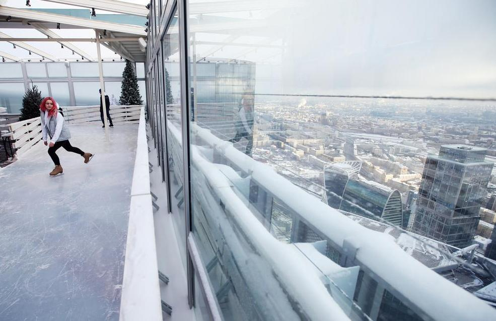 Visitors skate on the BMW Ice Rink 354 located on the 86th storey of the Moscow City OKO Tower.