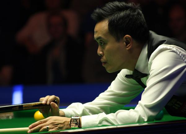 Marco Fu consigue su tercer título mundial al derrotar a John Higgins por 9-4