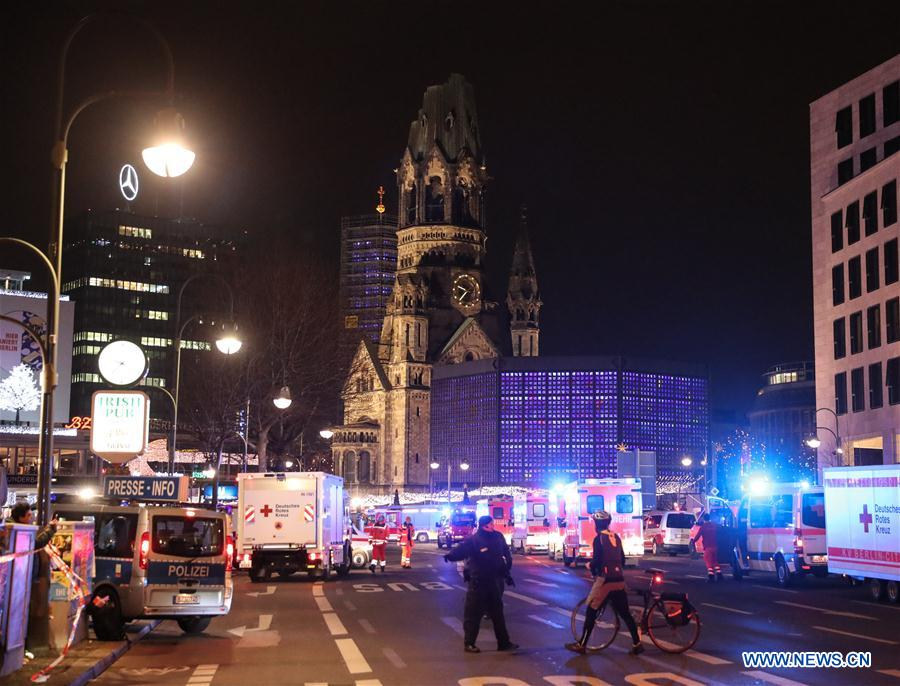 Police cordon off streets near the site of a lorry crash at a Christmas market in Berlin, Germany, Dec. 19, 2016. A lorry ploughed into a crowd at a Christmas market in Berlin on Monday night, killing nine people and injuring many others, Berlin police announced over Twitter. (Xinhua/Shan Yuqi)