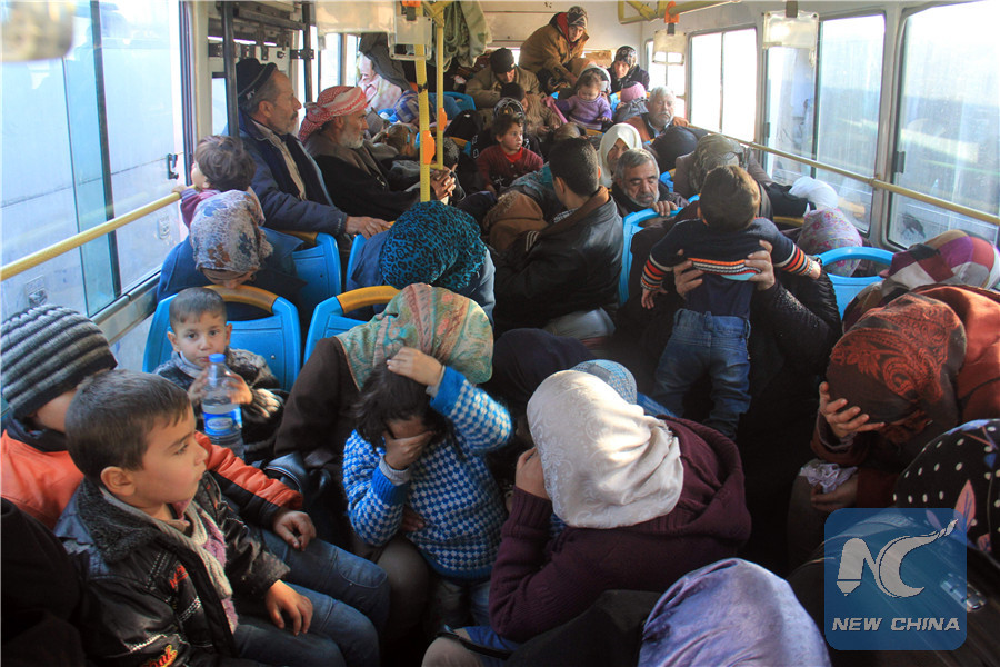 Residents from the mostly Shiite Syrian villages of Kafraya and Fuaa, which are besieged by opposition fighters, wait in a bus to get a green light from the rebels to cross into a government controlled area in the province of Aleppo, on December 20, 2016. (AFP/Xinhua)