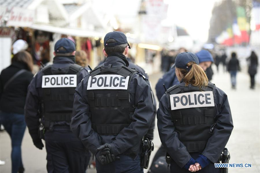 Police officers patrol at a Christmas market along the Champs-Elysees in Paris, capital of France, on Dec. 20, 2016. French Interior Minister Bruno Le Roux on Monday decided to reinforce security at France