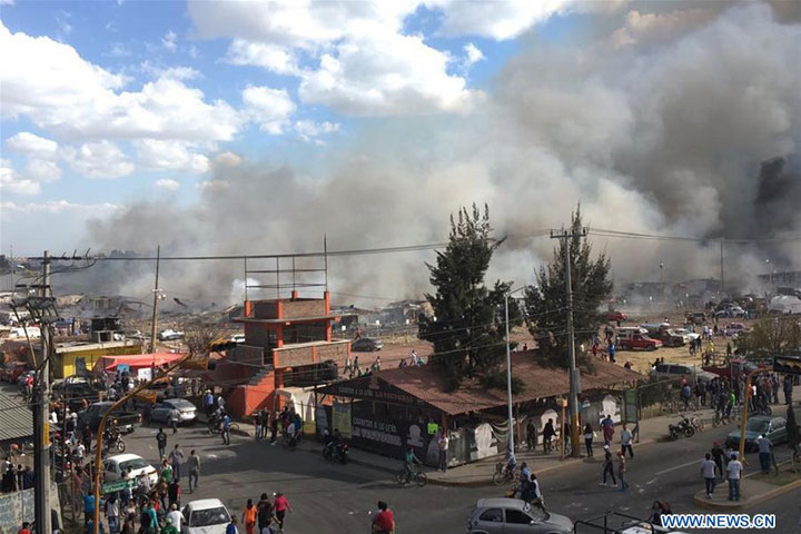 Photo taken by a mobile device on Dec. 20, 2016 shows the site of a blast at the San Pablito fireworks market in Tultepec, Mexico. At least 60 people were injured in an explosion Tuesday at the San Pablito fireworks market in Tultepec, a town in the State of Mexico, Luis Felipe Puente, director of Civil Protection, said. [Photo: Xinhua]