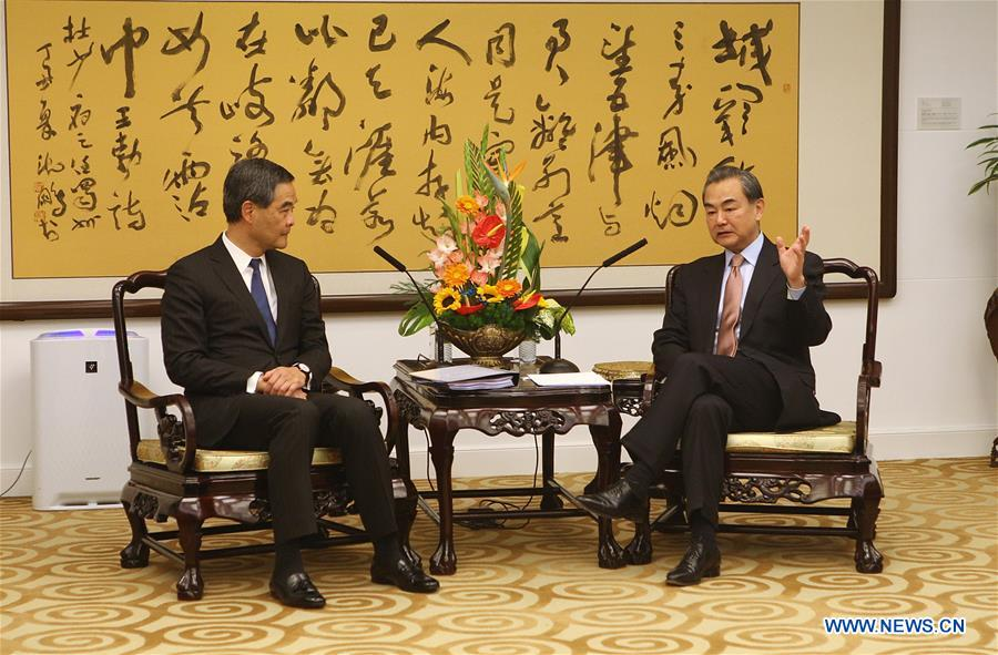 Chinese Foreign Minister Wang Yi (R) meets with Leung Chun-ying, Chief Executive of China