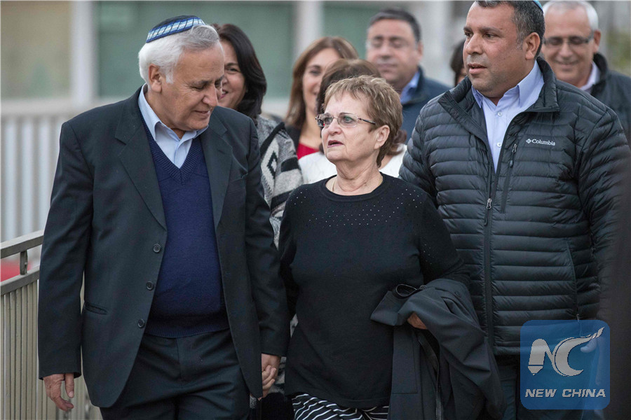 Former Israeli president Moshe Katsav (L), 71, is accompanied by his wife Gila (C-R), as he leaves prison on December 21, 2016 in Ramla. (AFP/Xinhua)