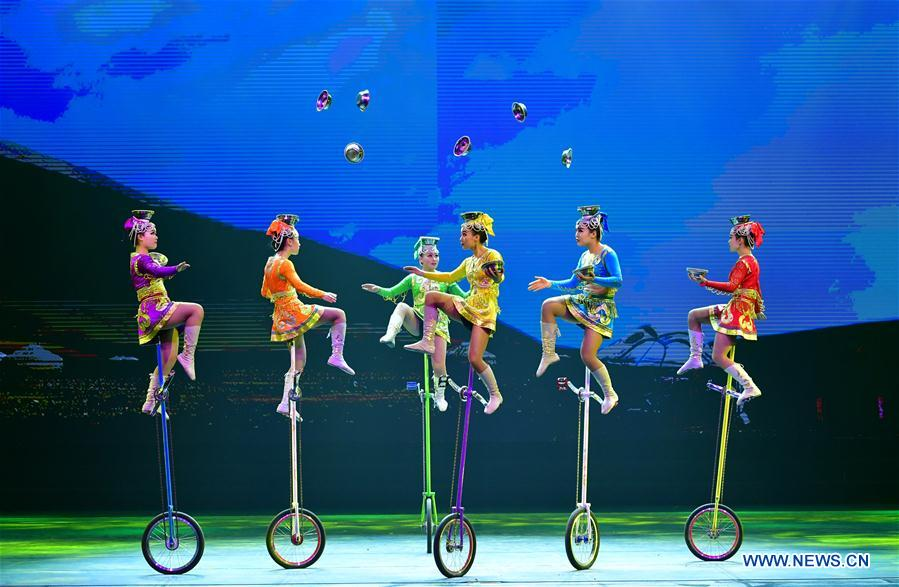 Acrobats perform during the closing ceremony of the 3rd Chinese acrobatics art festival in Luoyang, central China