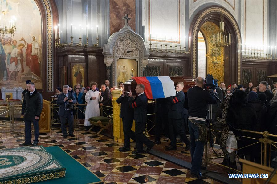 Pallbearers carry the casket of slain Russian Ambassador to Turkey Andrei Karlov during the funeral ceremony at the Christ the Saviour Cathedral in Moscow, Russia, Thursday, Dec. 22, 2016. Karlov was shot dead by a Turkish policeman Monday in Ankara, Turkey.(Xinhua/Bai Xueqi)