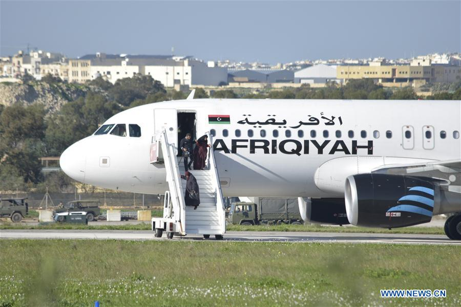 The released people from the hijacked Libyan plane step off the plane at Malta International Airport, Valletta, Malta, on Dec. 23, 2016. The two hijackers of a Libyan internal flight have surrendered, searched and taken into custody at the Malta International Airport, Maltese Prime Minister Joseph Muscat said Friday on Twitter. (Xinhua/Mark Zammit Codina)