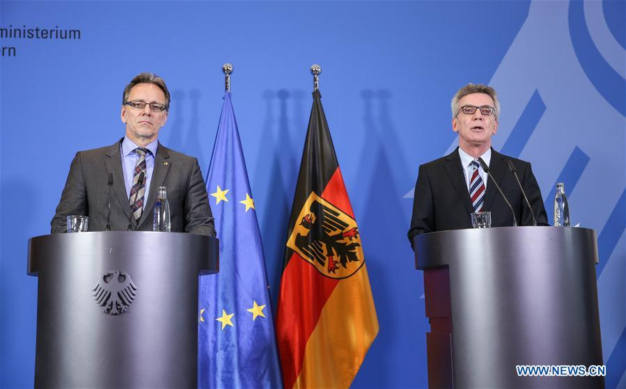 German Interior Minister Thomas de Maiziere (R) and President of German Federal Criminal Police Office Holger Muench attend a press conference in Berlin, Germany, on Dec. 23, 2016. German Interior Minister Thomas de Maiziere on Friday confirmed the death of Anis Amri, a man suspected of committing a truck attack on a Christmas market in downtown Berlin on Monday evening, the Deutsche Presse Agentur (DPA) reported. (Xinhua/Shan Yuqi)