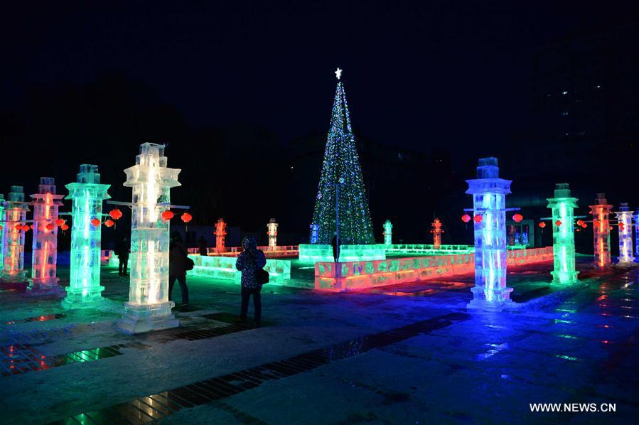 People enjoy lanterns during the 43rd Ice Lantern Exhibition in Harbin, capital of northeast China