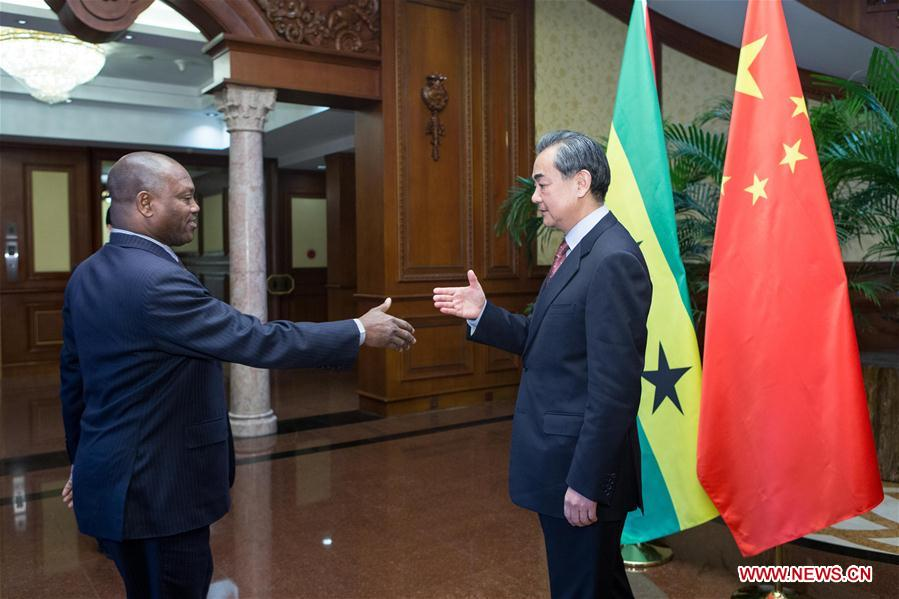 Chinese Foreign Minister Wang Yi (R) holds talks with his counterpart of Sao Tome and Principe Urbino Botelho in Beijing, capital of China, Dec. 26, 2016. (Xinhua/Cui Xinyu)