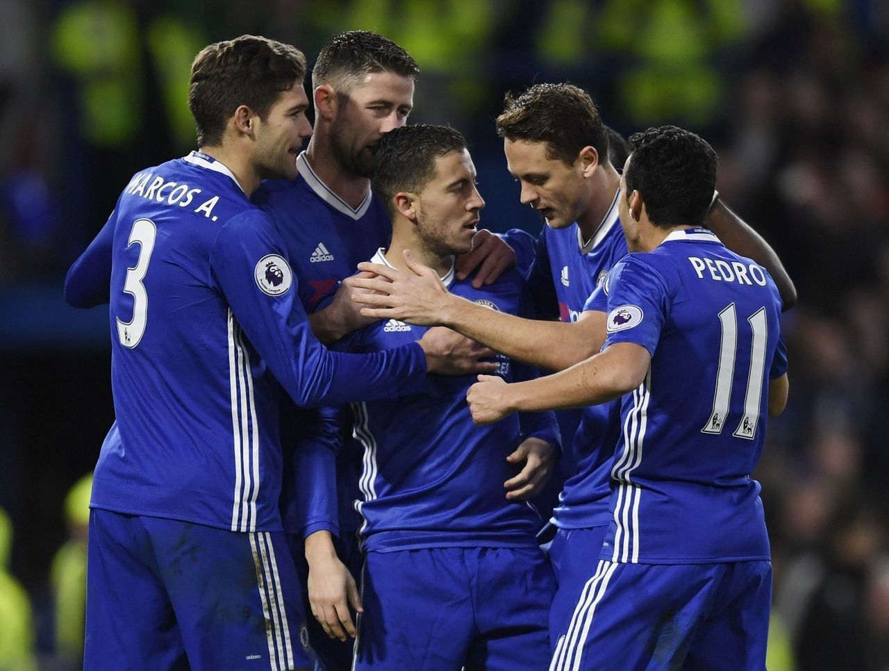 Chelsea set a club record with its 12th consecutive Premier League victory on Monday, Eden Hazard stealing the show at Stamford Bridge to lead the Blues to a 3-0 triumph over Bournemouth.