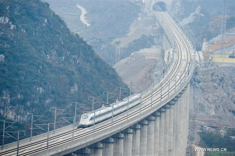 A test train in seen on the Guizhou West section of the Shanghai-Kunming high-speed railway, Dec. 17, 2016. China on Wednesday put into operation one of the world