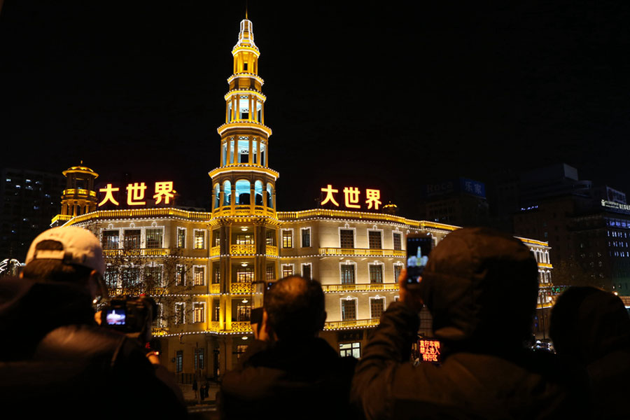 Visitors take photos of the Shanghai Dashijie in Shanghai, on Dec 28, 2016. [Photo/VCG]