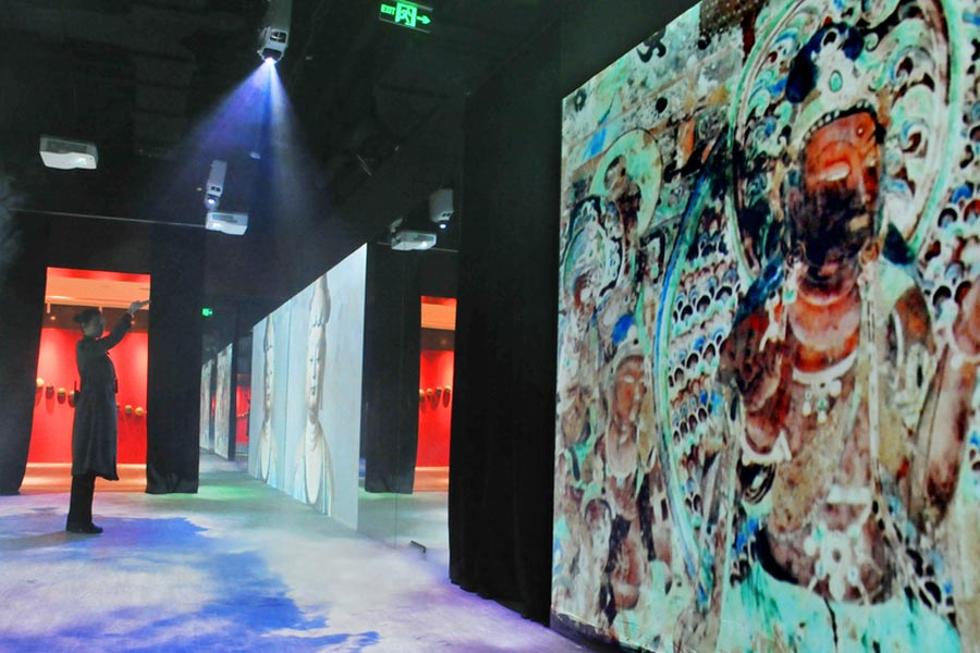 The images of Dunhuang frescoes are displayed on electronic screens at Shanghai Dashijie on Dec 28, 2016. [Photo/VCG]