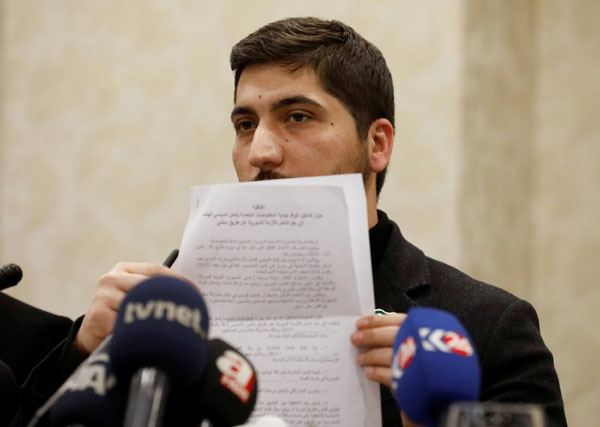 Osama Abu Zaid, a spokesman for the Free Syrian Army rebel alliance, shows the text of the agreement about a ceasefire between Syrian opposition groups and the Syrian government during a news conference in Ankara, Turkey, December 29, 2016. [Photo/Agencies]