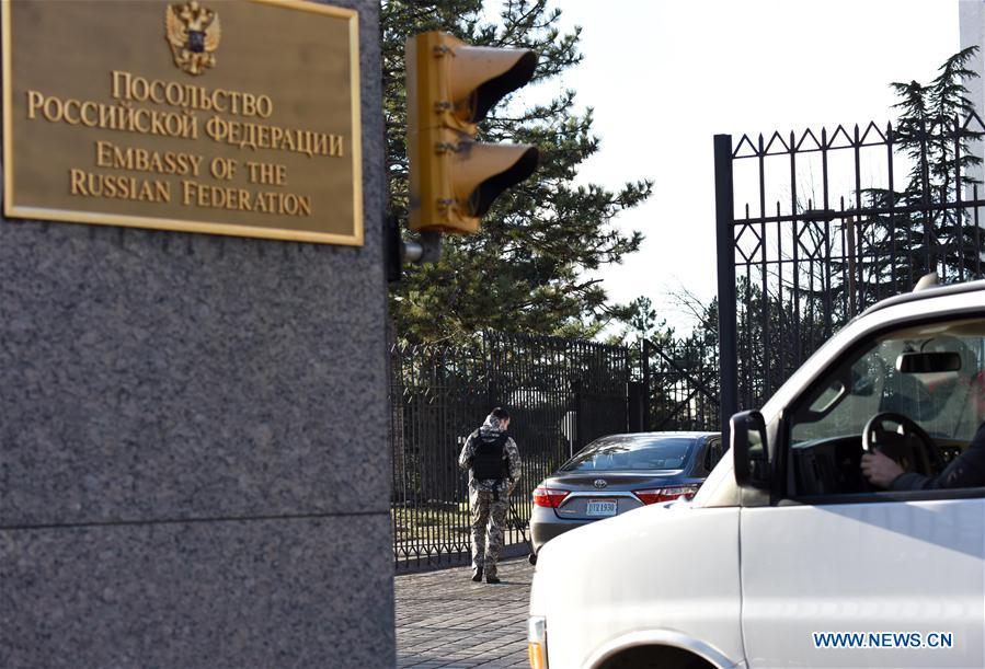 Vehicles wait for security check when entering the Russian Embassy to the United States in Washington D.C., the United States, on Dec. 29, 2016. The White House on Thursday announced sanctions against Russian entities and individuals over alleged hacking during the 2016 U.S. presidential election. In addition, the U.S. State Department on Thursday announced ejection of 35 Russian government officials from the United States. (Xinhua/Yin Bogu)