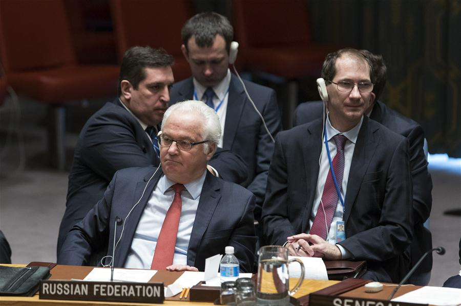 Vitaly Churkin(front), Russian permanent representative to the United Nations, is pictured after the Security Council adopted a resolution endorsing the Syria cease-fire arrangement brokered by Russia and Turkey as well as the new peace talks plan among Syrian conflict parties at the UN headquarters in New York, Dec. 31, 2016. The UN Security Council on Saturday unanimously adopted a resolution supporting the Syria cease-fire arrangement brokered by Russia and Turkey as well as a new peace talks plan among Syrian conflict parties. (Xinhua/Li Muzi)