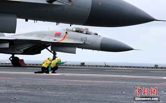 """The fighter """"Flying Shark"""" ready for takeoff on the deck of China"""