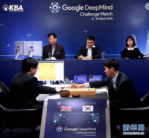 South Korean professional Go player Lee Sedol, right, puts a stone against Google