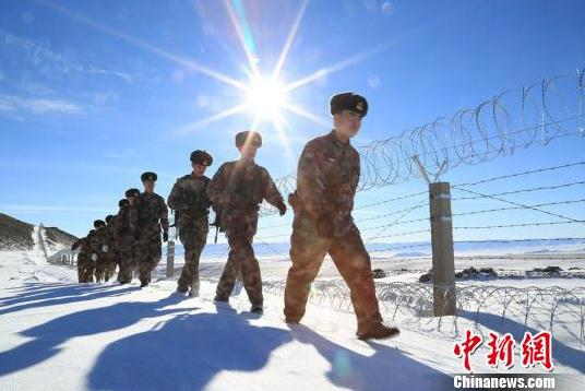militiamen and corps of tacheng city in xinjiang patrol at a height of 2000 meters on