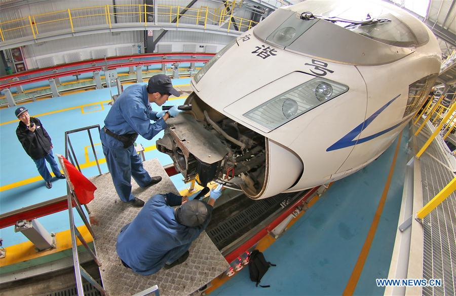 Mechanics check a bullet train in Qingdao City, east China