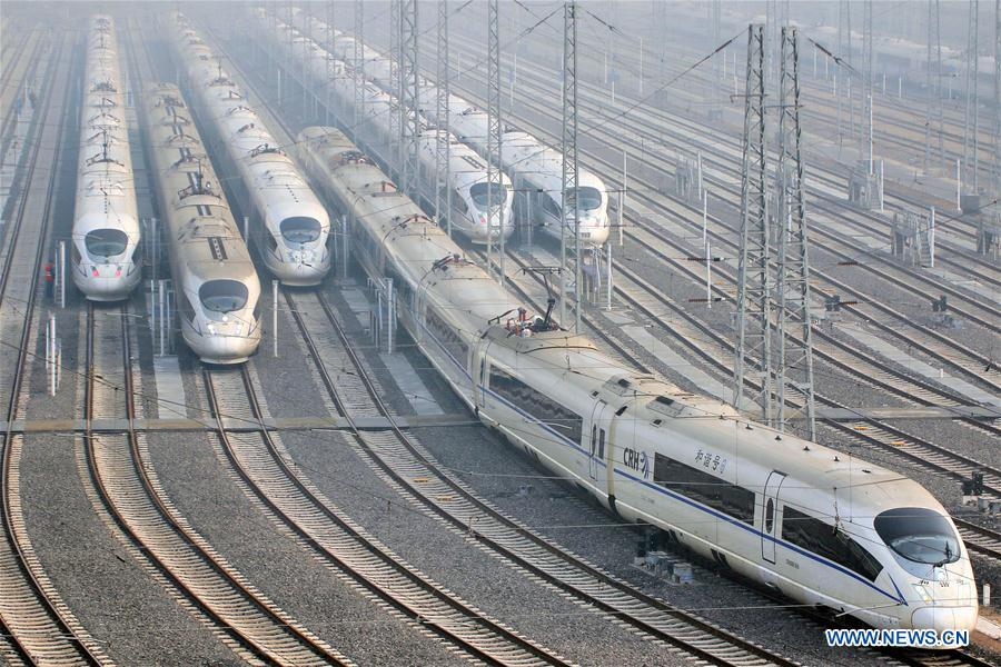 Bullet trains wait on the high-speed railway depot in Qingdao City, east China