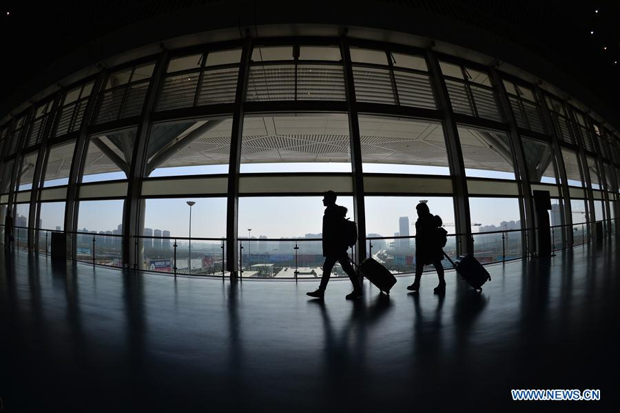 Passengers prepare to get on bullet trains in Xi