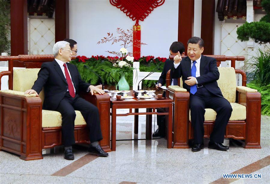 Chinese President Xi Jinping (R), who is also General Secretary of the Communist Party of China Central Committee, and Nguyen Phu Trong, General Secretary of the Communist Party of Vietnam Central Committee, have a tea chat after their talks in Beijing, capital of China, Jan. 12, 2017. (Xinhua/Ju Peng)