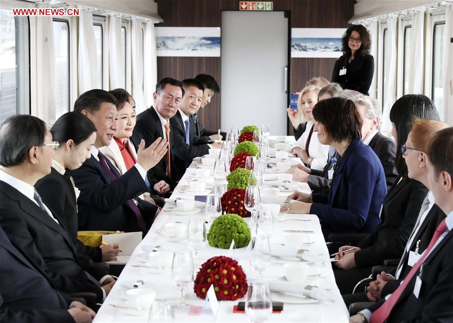 Chinese President Xi Jinping and his wife Peng Liyuan enjoy tea and conversation with Swiss President Doris Leuthard and her husband Roland Hausin in a special train on their way to Bern, capital of Switzerland, Jan. 15, 2017. After the welcome ceremony at the Zurich airport, Xi traveled to the Swiss capital of Bern by a special train of the Swiss government. (Xinhua/Lan Hongguang)