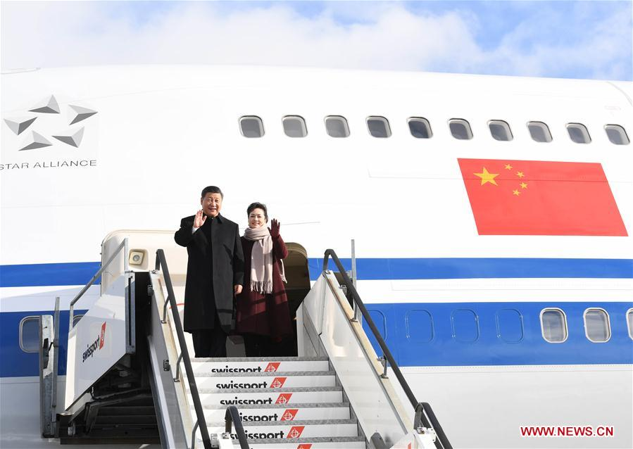 Chinese President Xi Jinping and his wife Peng Liyuan walk out of the plane after arrival in Zurich, Switzerland, Jan. 15, 2017. Chinese President Xi Jinping arrived here Sunday to pay a state visit to Switzerland and attend the 2017 annual meeting of the World Economic Forum (WEF) in Davos. (Xinhua/Rao Aimin)