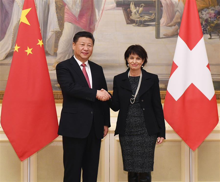 Chinese President Xi Jinping (L) shakes hands with his Swiss counterpart Doris Leuthard in Bern, Switzerland, Jan. 16, 2017. (Xinhua/Rao Aimin)