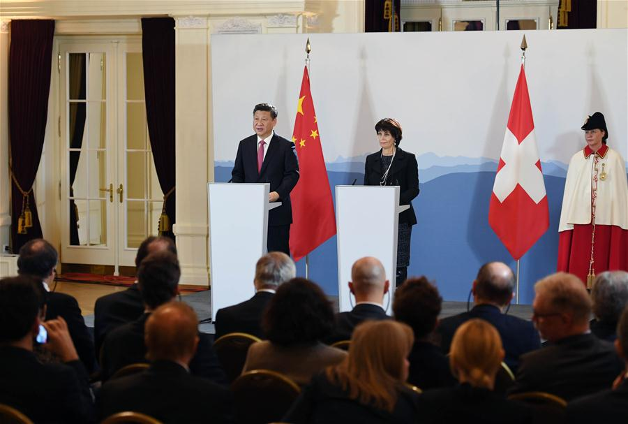 Chinese President Xi Jinping and his Swiss counterpart Doris Leuthard meet journalists after their talks in Bern, Switzerland, Jan. 16, 2017. (Xinhua/Rao Aimin)