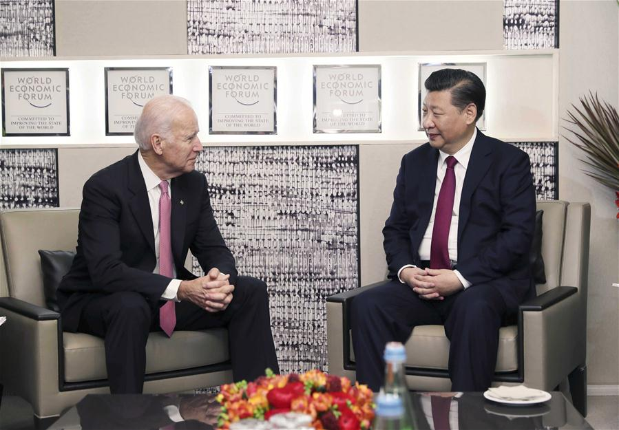Chinese President Xi Jinping (R) meets with U.S. Vice President Joe Biden in Davos, Switzerland, Jan. 17, 2017. (Xinhua/Lan Hongguang)