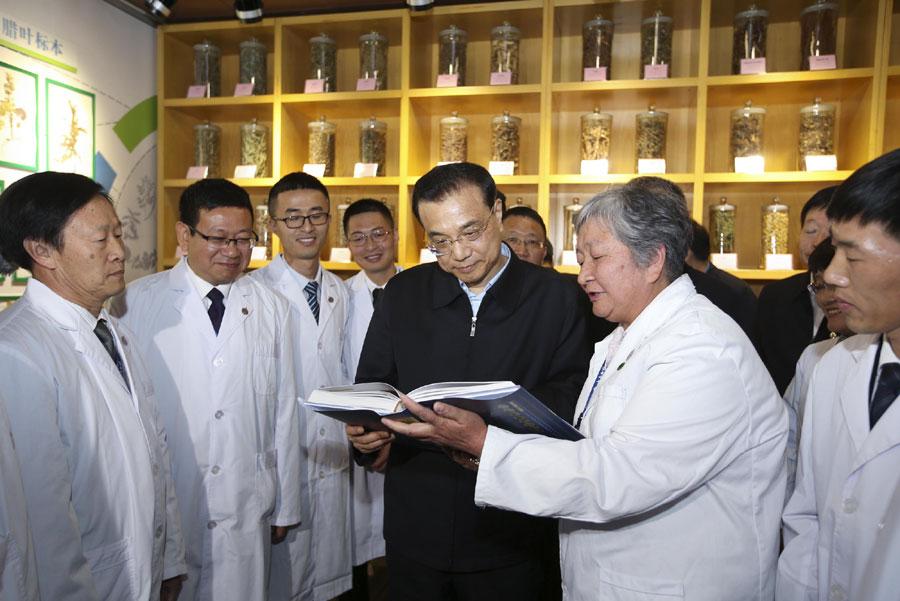 Chinese Premier Li Keqiang visits Yunnan Baiyao Group on Tuesday, January 24, 2017, in Kunming, southwest China