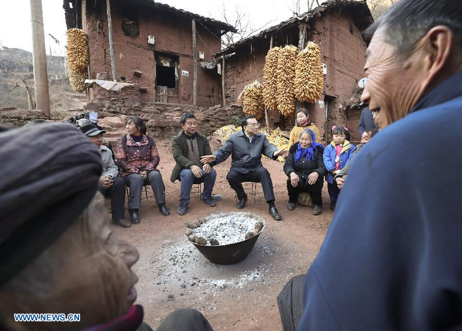 Chinese Premier Li Keqiang visits villagers of Lianhe Village in Zhaoyang District of Zhaotong City, southwest China