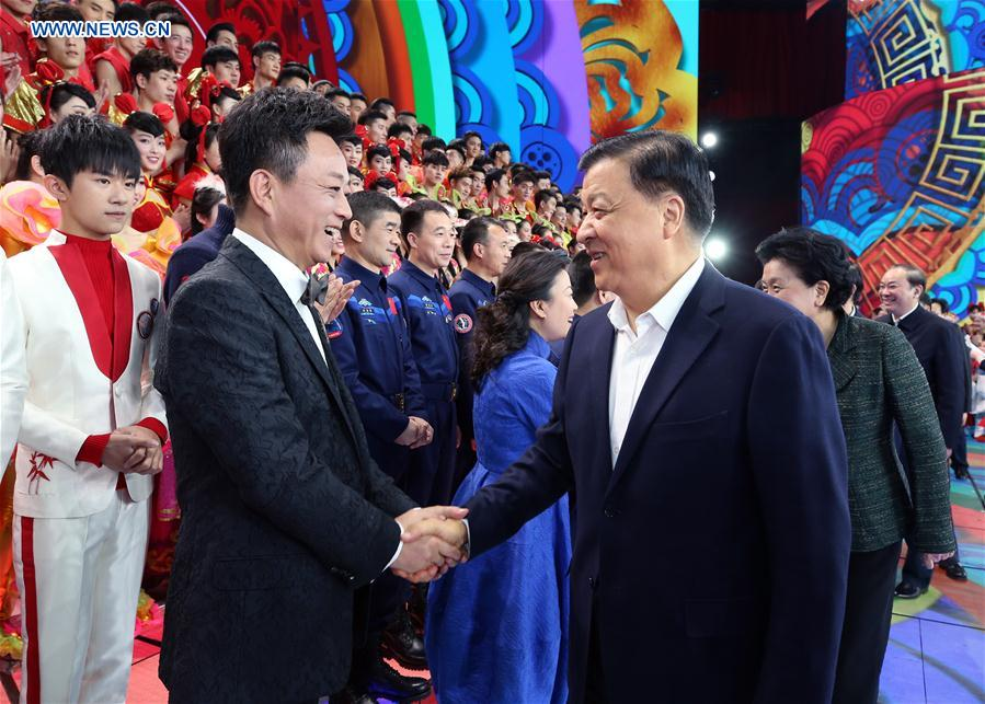 Liu Yunshan (R front), a member of the Standing Committee of the Political Bureau of the Communist Party of China Central Committee, visits and extends Spring Festival greetings to staffs at the rehearsal for the Spring Festival TV gala in Beijing, capital of China, Jan. 25, 2017. The gala, an annual celebration broadcast by the China Central Television on the Chinese New Year