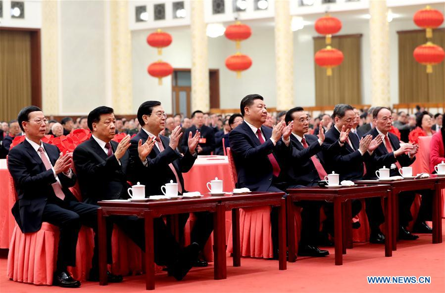 Chinese President Xi Jinping (C) and other top Chinese leaders Li Keqiang (3rd R), Zhang Dejiang (3rd L), Yu Zhengsheng (2nd R), Liu Yunshan (2nd L), Wang Qishan (1st R) and Zhang Gaoli (1st L) attend a reception for the Spring Festival with members of the public in Beijing, capital of China, Jan. 26, 2017. This year