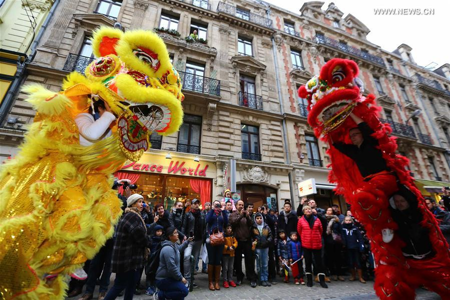 Lion dancers take part in the Chinese Lunar New Year Parade in downtown Brussels, Belgium, on Jan. 28, 2017. (Xinhua/Gong Bing)