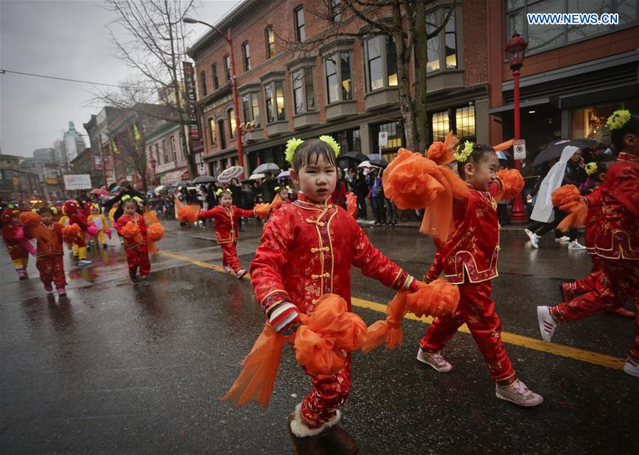 Children perform dancing during the Chinese Lunar New Year parade in Vancouver, Canada, Jan. 29, 2017. More than 70 parade troops with 3,000 participants paraded along the streets of Chinatown to celebrate the Year of the Rooster. (Xinhua/Liang Sen)