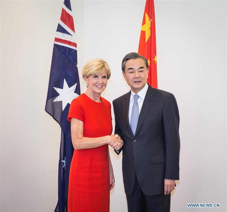 Chinese Foreign Minister Wang Yi (R) shakes hands with his Australian counterpart Julie Bishop prior to the two countries