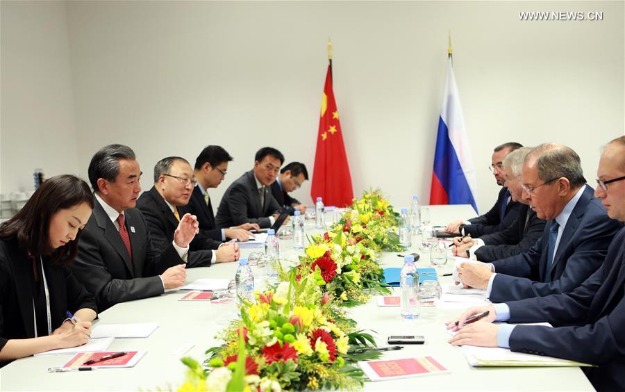 وزيرا الخارجية الصيني والروسي يجتمعان في ألمانيا