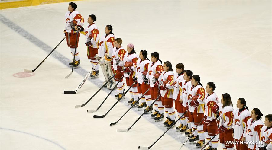 Players of China line up during the national anthem ceremony ahead of the women